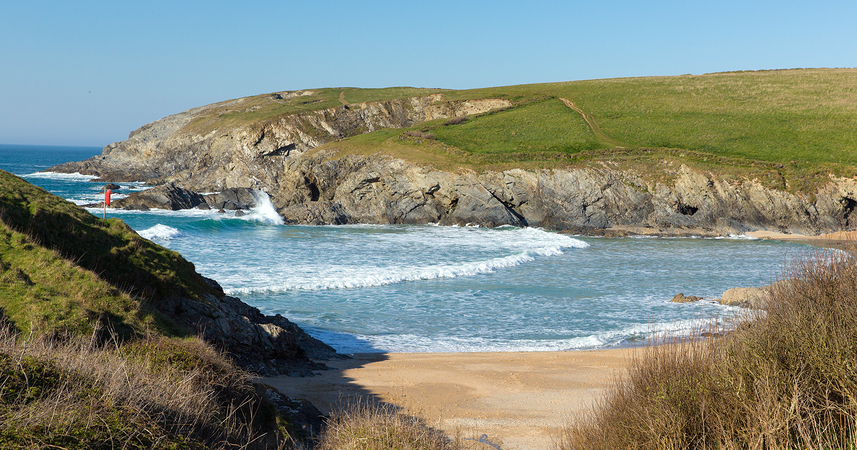 Porth Joke beach next to Crantock bay Cornwall England UK near Newquay and on South West Coast Path also known as Polly Joke in spring with blue sea and sky