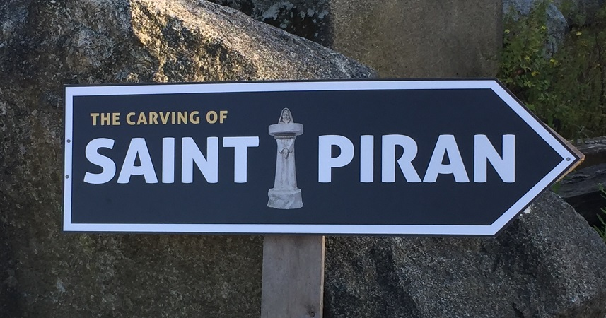 A 3.5m St Piran carved in Cornish Granite by David Paton and Stéphane Rouget.