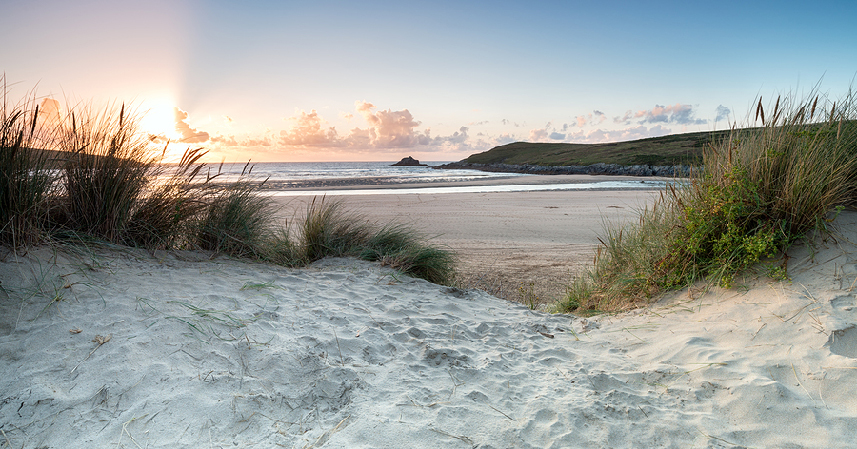 Sunset through the sand dunes at Crantock beach near Newquay in Cornwall