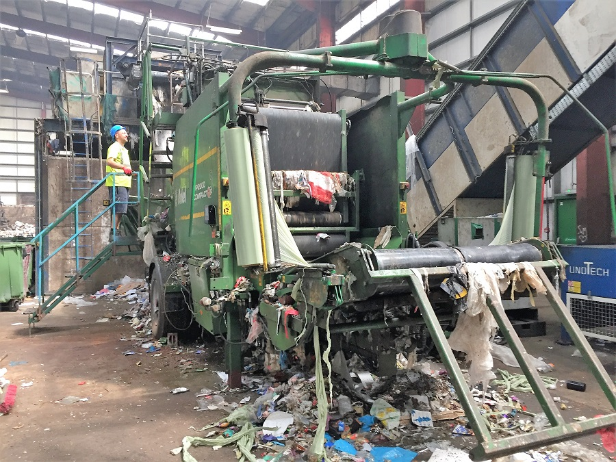 Waste is sorted by machine and hand at H&A Recycling