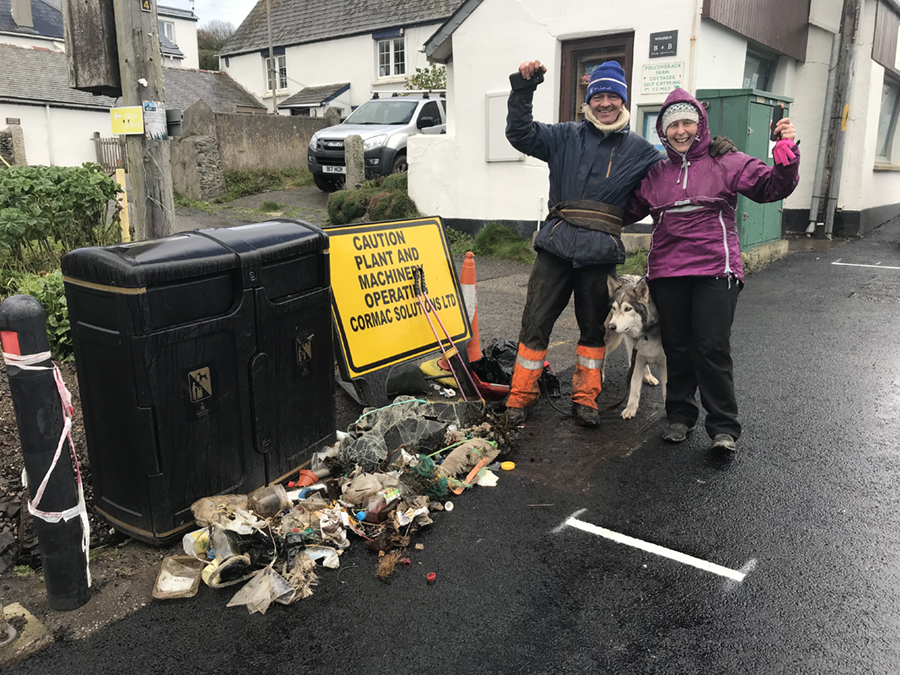 Wayne Dixon and Action Nan Pat Smith with their haul of litter removed from Coverack beach in Cornwall