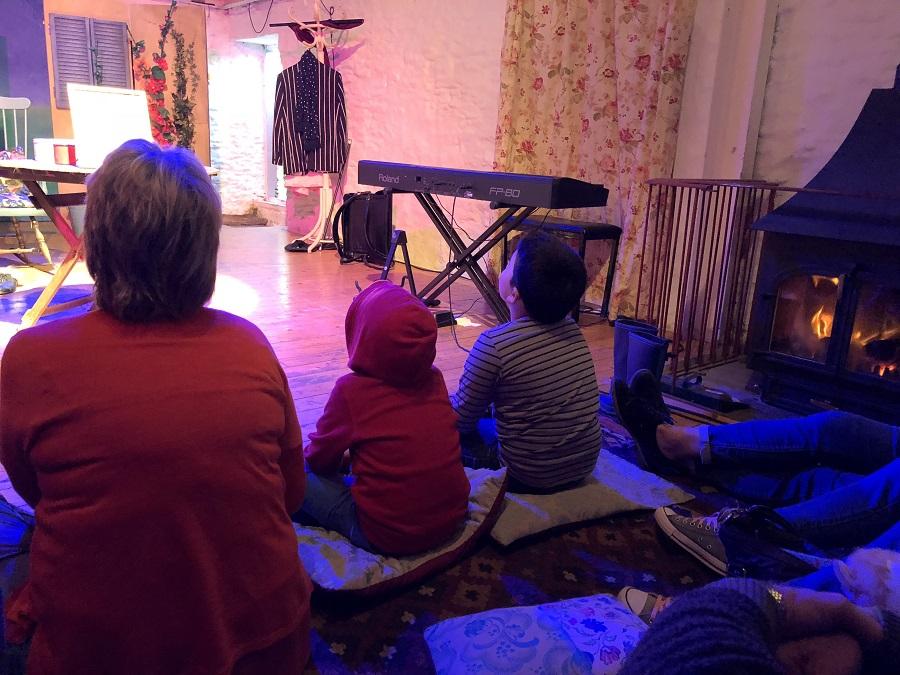 Audience watching Kneehigh theatre performance