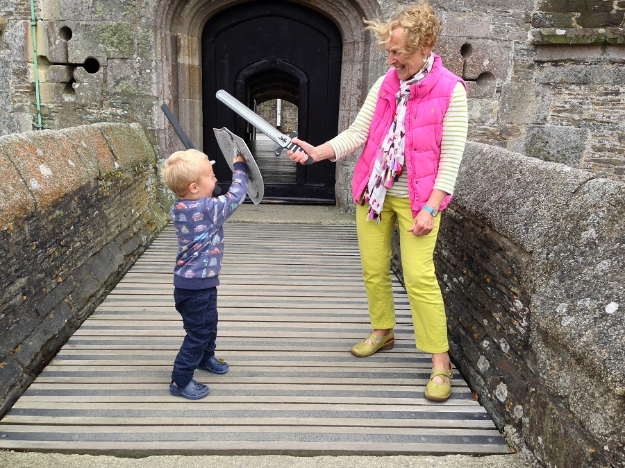 Nanny Pat sword fighting with grandson Sam at Pendennis Castle