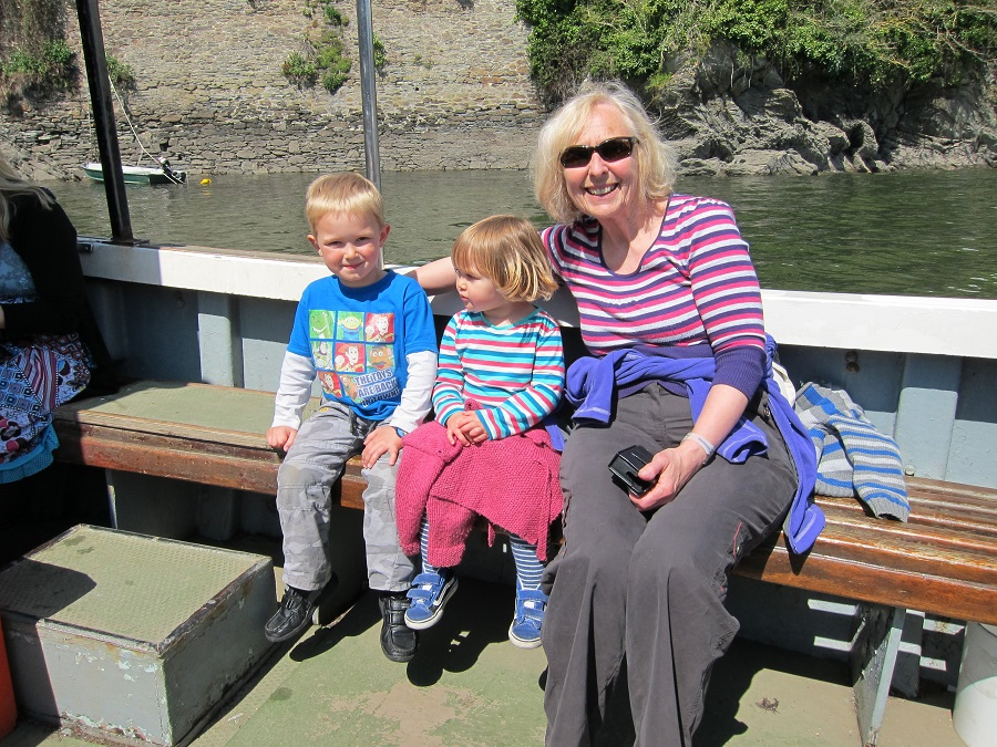 Nanny Pat with grandchildren on a boat trip